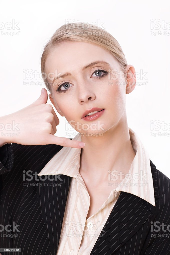 Business woman gesturing a call me sign royalty-free stock photo