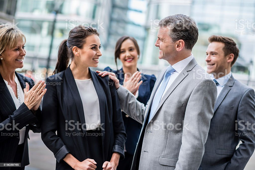 Business woman getting a promotion stock photo