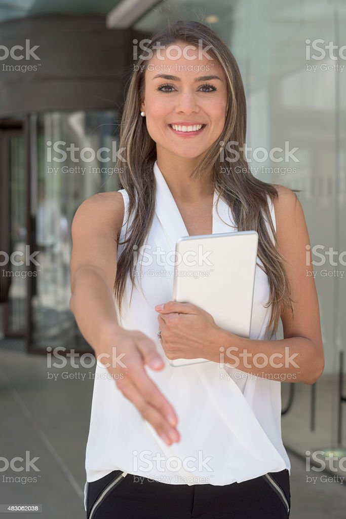 Business woman giving a handshake stock photo