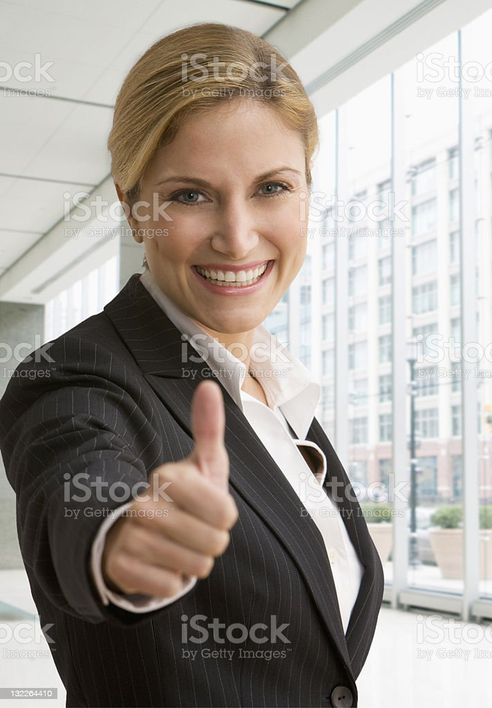 Business woman giving thumbs up royalty-free stock photo