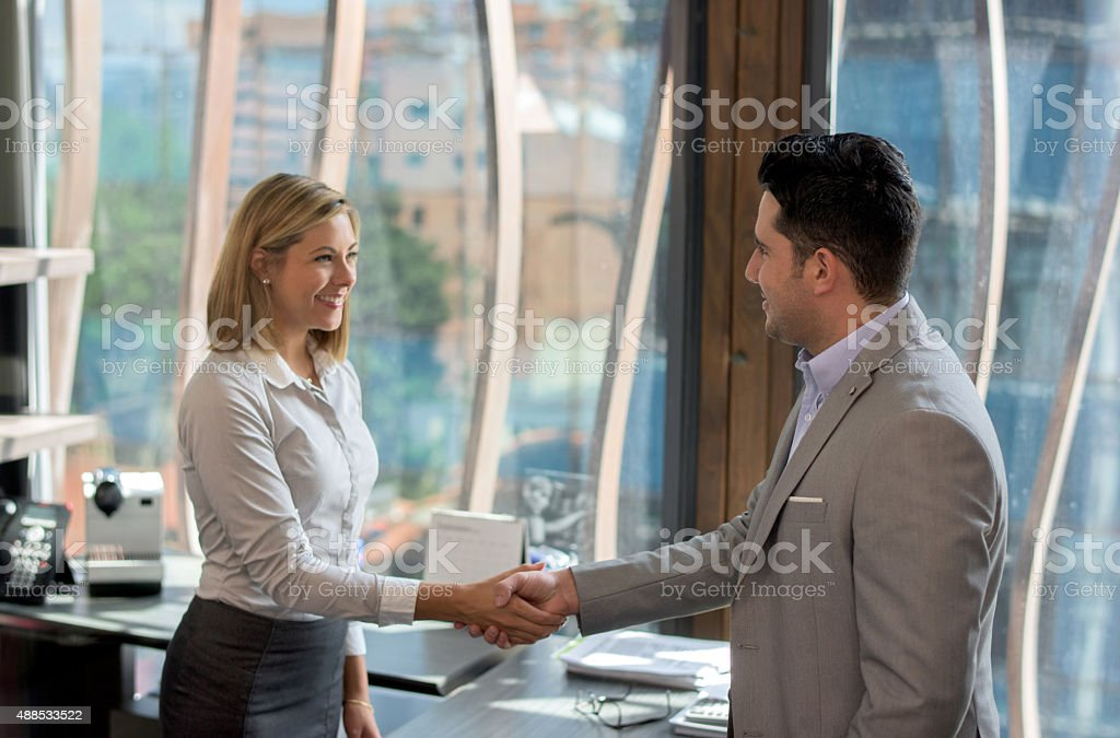 Business woman greeting a client stock photo