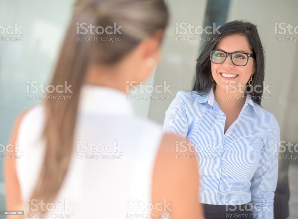 Business woman greeting with a handshake stock photo