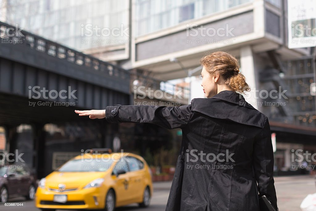 Business Woman hailing taxi in NY city stock photo