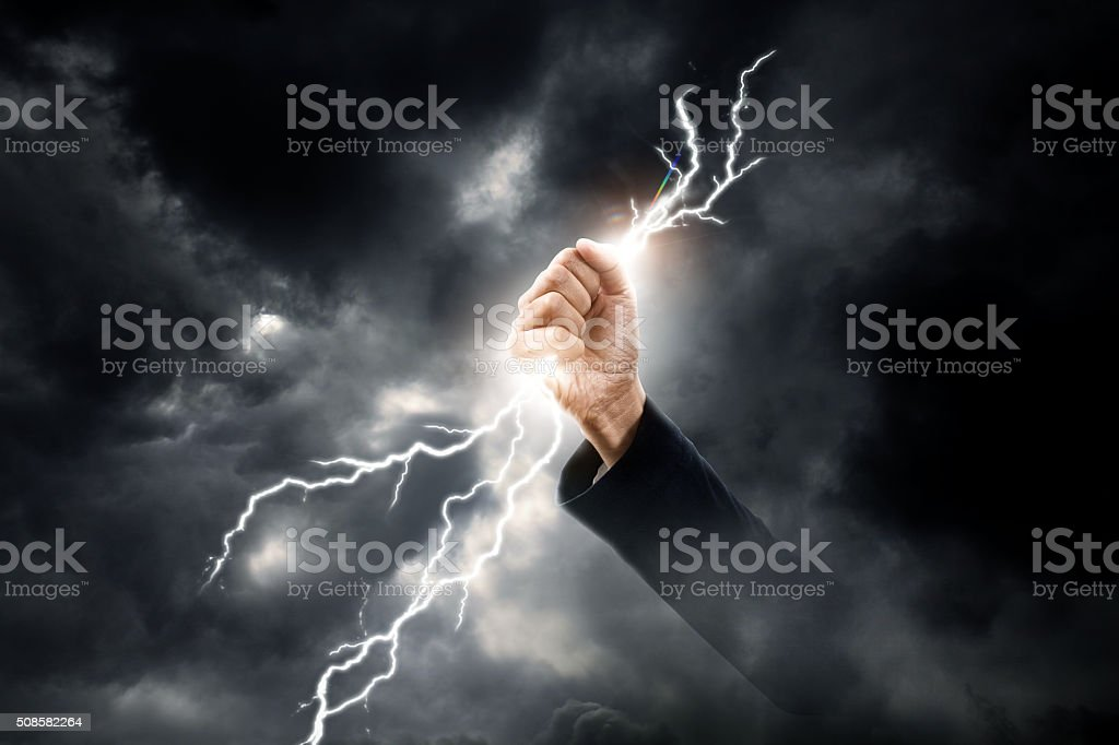 business woman hand clenching lightning flash stock photo