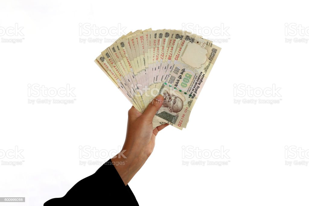 Business woman hand holding Indian currency stock photo
