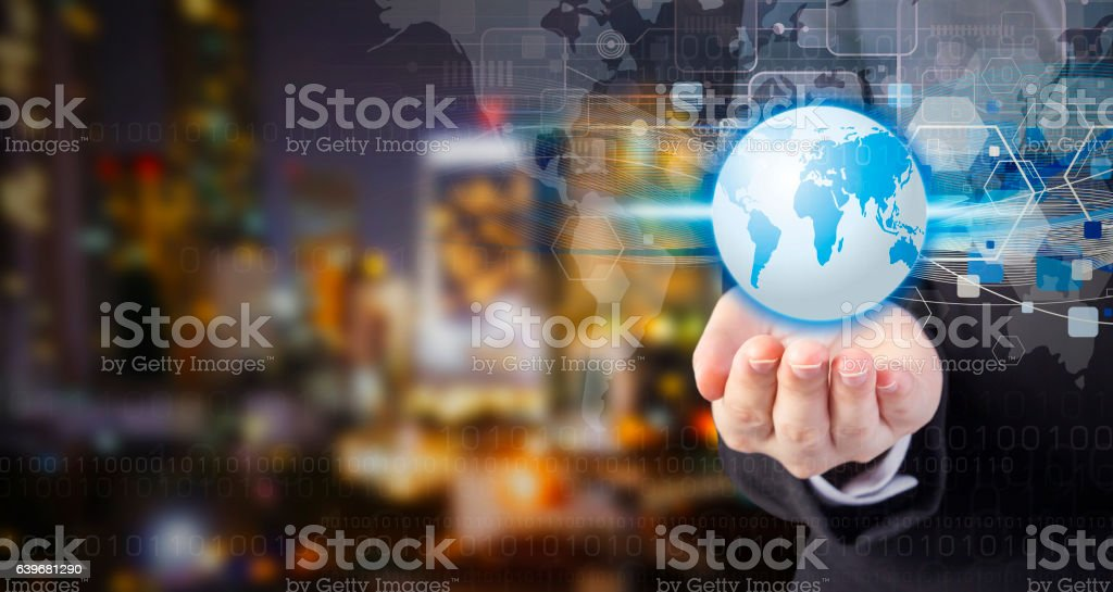 Business woman hand holding world with technology design stock photo