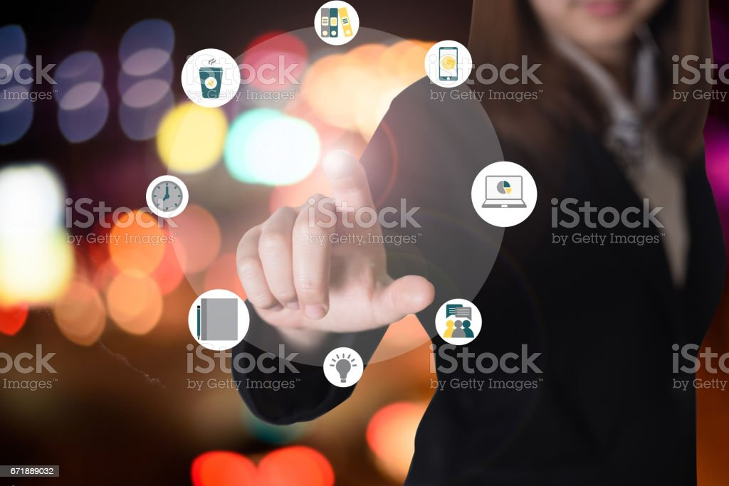 Business woman hand pushing button stock photo