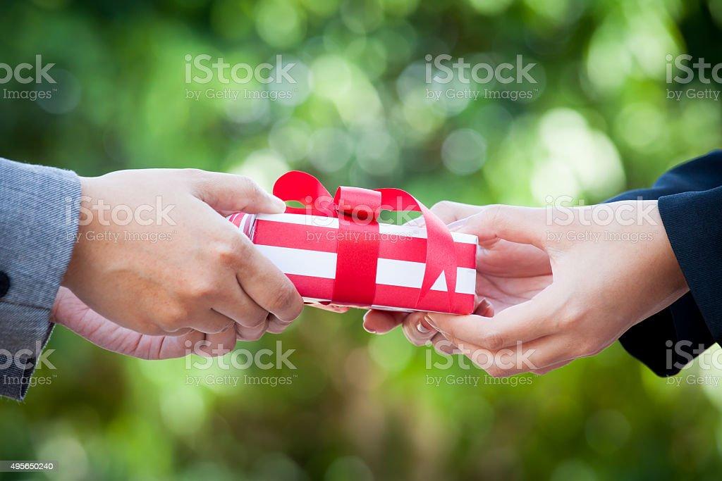 Business woman hand with christmas gift box stock photo