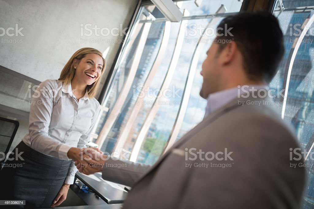 Business woman handshaking with a client stock photo