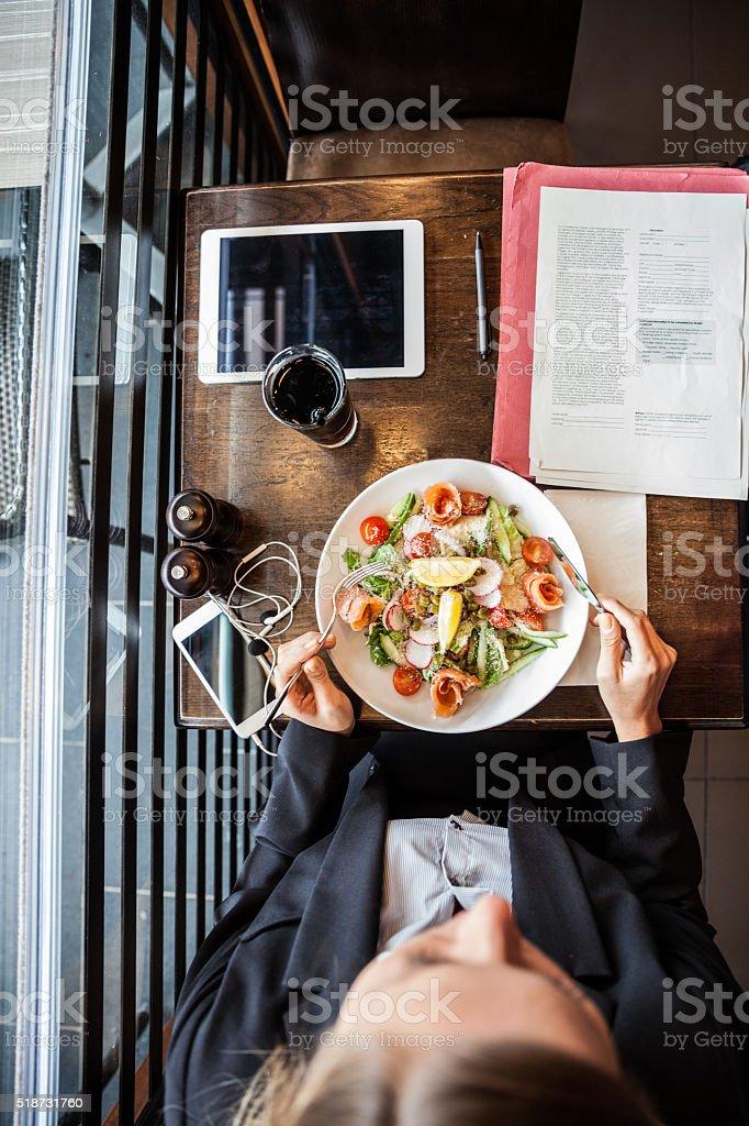 Business woman having a break in a restaurant stock photo