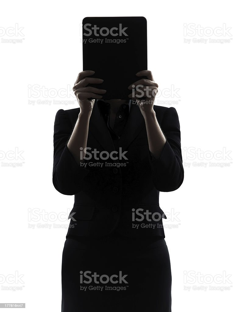 business woman hiding computer computing  digital tablet silhouette royalty-free stock photo
