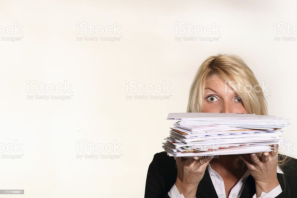 Business woman hold stack of Junk Mail and unpaid bills stock photo