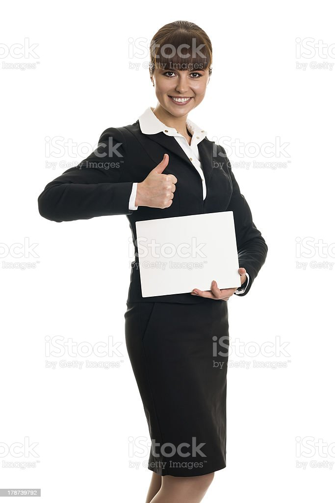 Business woman holding a card and thumbs-up royalty-free stock photo