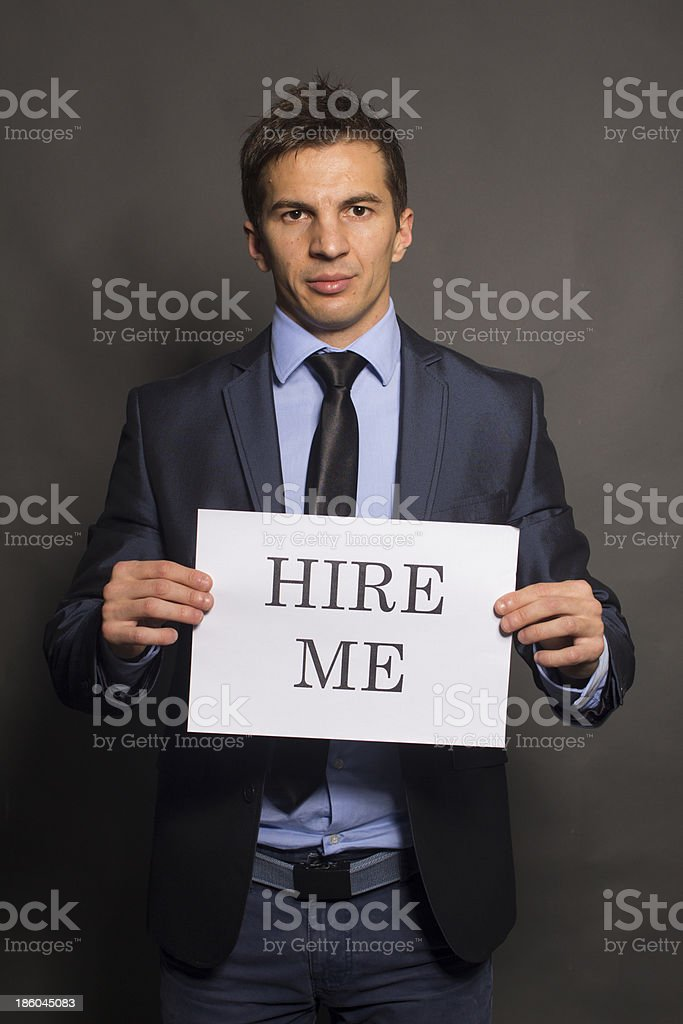 Business woman holding a card royalty-free stock photo