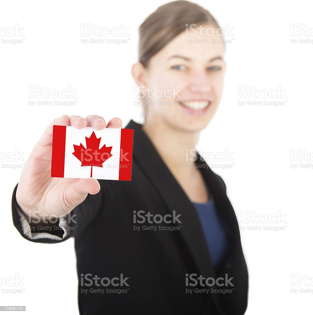 business woman holding a card with the Canadian flag royalty-free stock photo