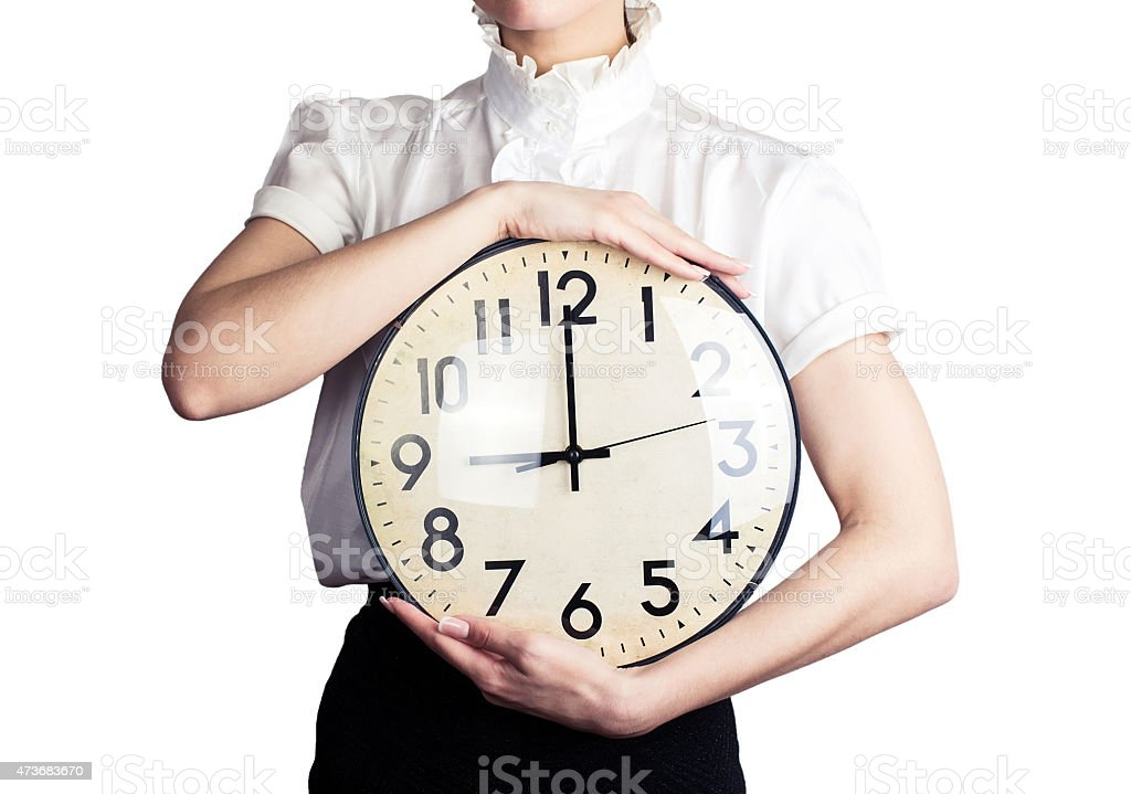 Business woman holding a clock stock photo