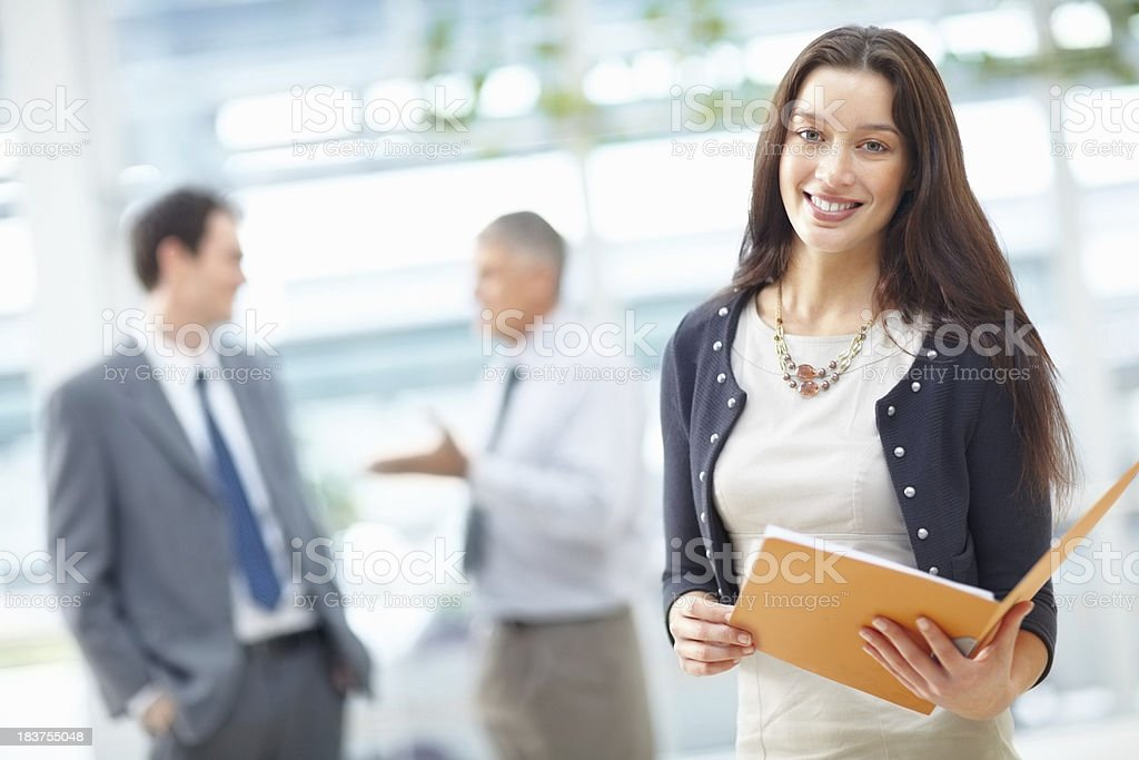Business woman holding a file stock photo