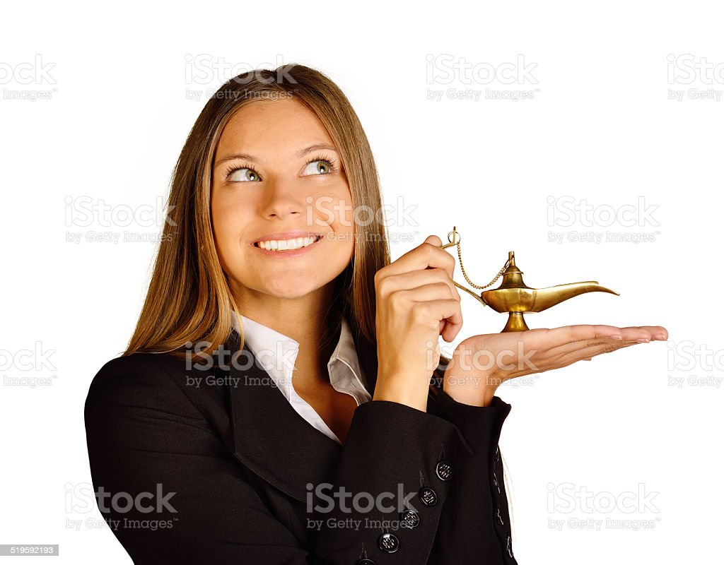 Business woman holding a lamp of Aladdin. stock photo