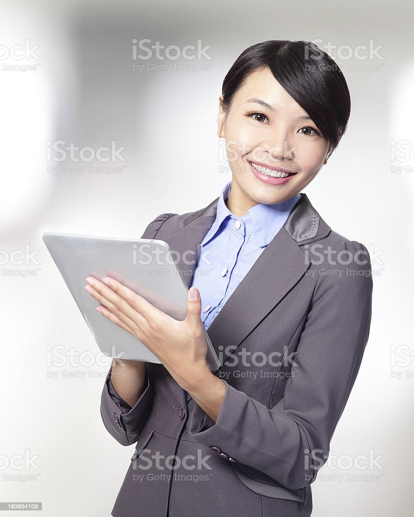 business woman holding a tablet pc royalty-free stock photo