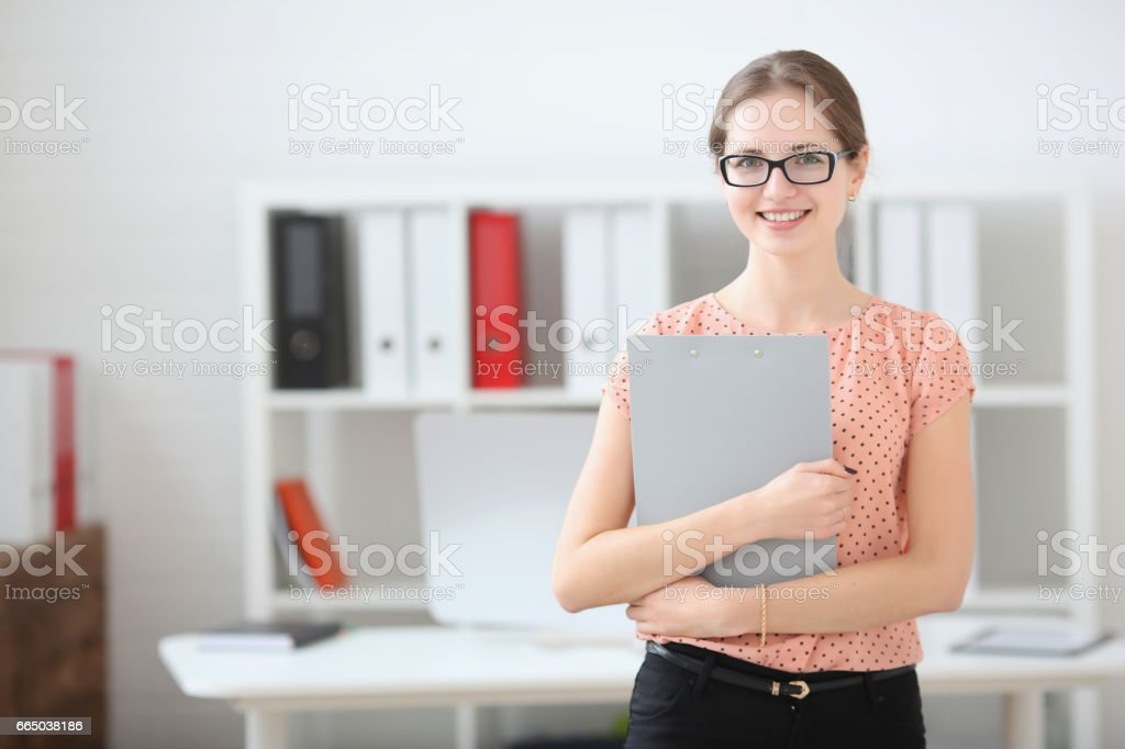 Business woman holding a writing tablet in the office stock photo