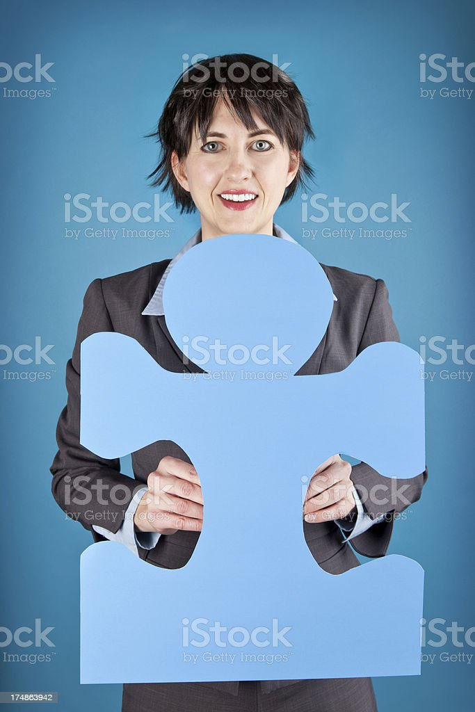 Business Woman Holding Blue Puzzle Piece royalty-free stock photo