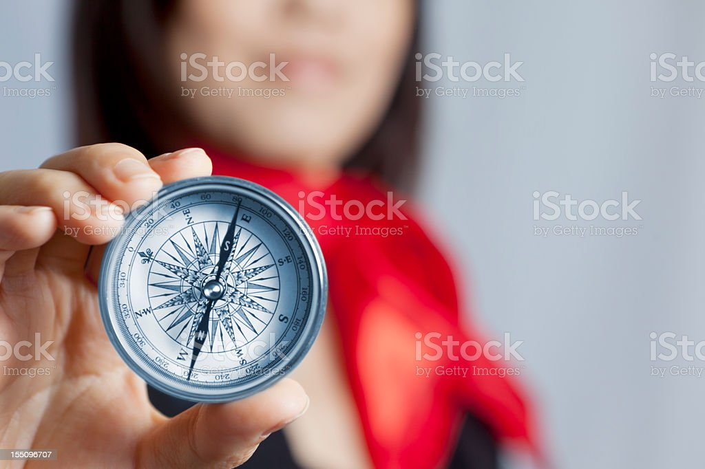 Business woman holding compass stock photo