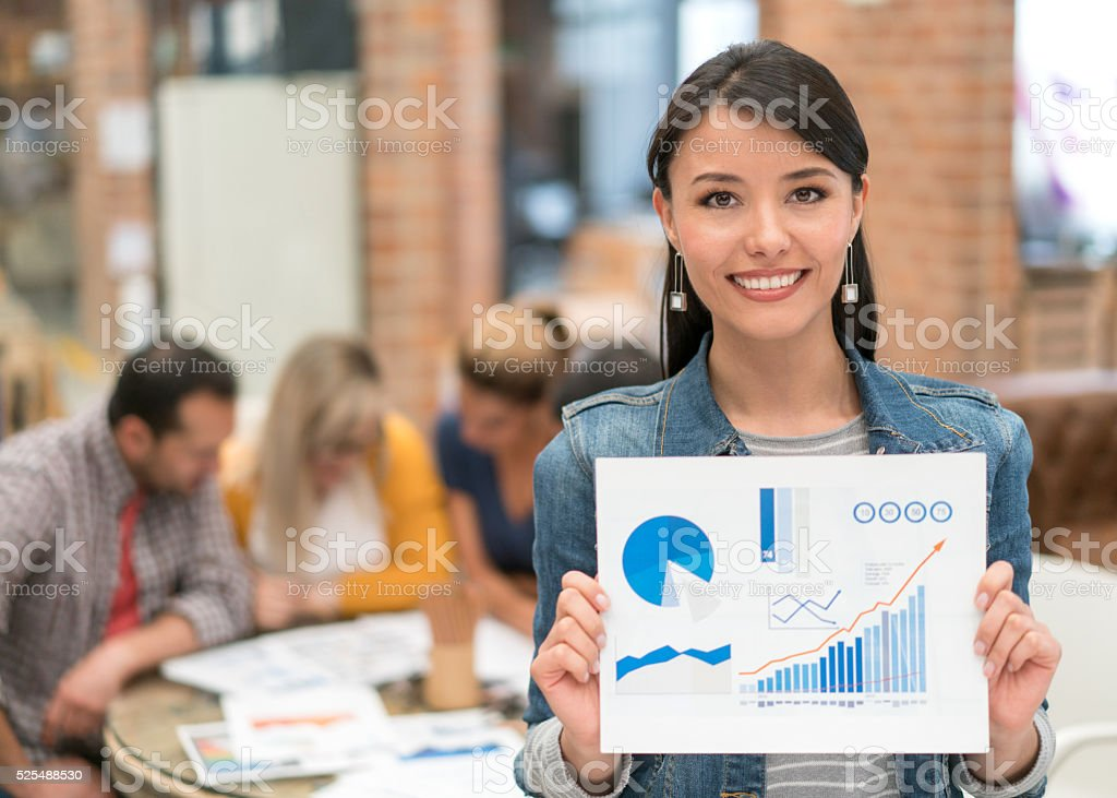 Business woman holding document at the office stock photo