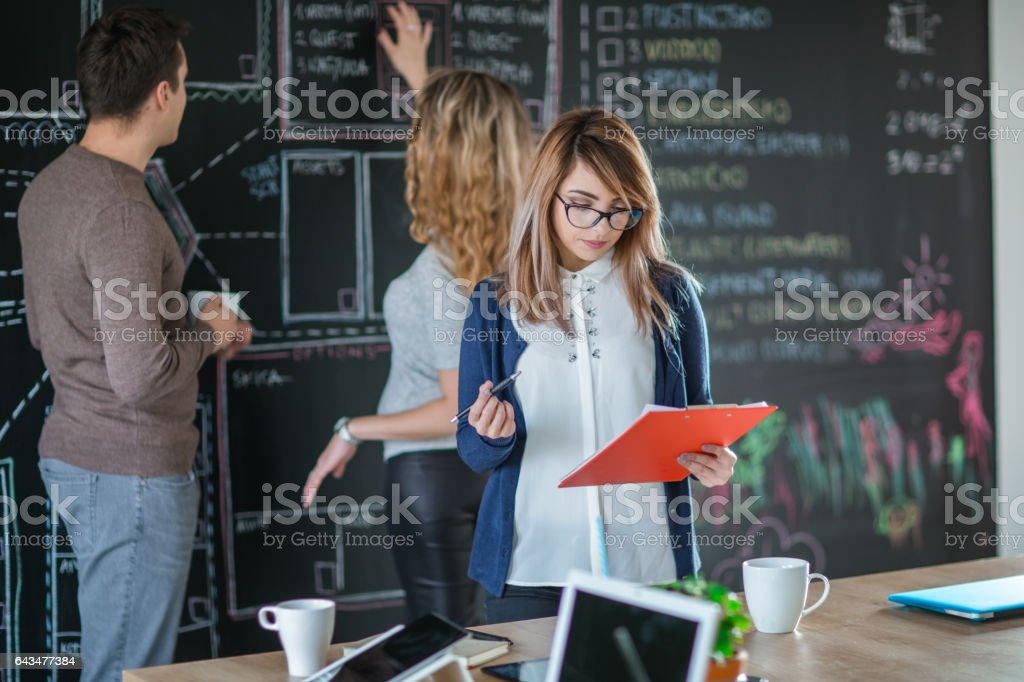 Business woman holding documents in the office stock photo