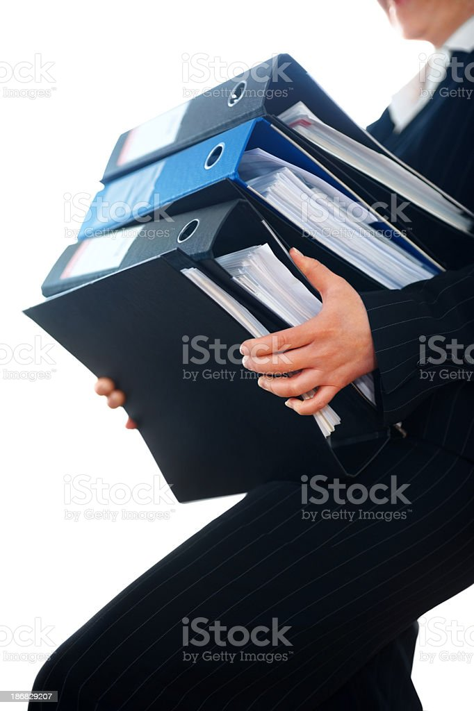 Business woman holding heavy files on white royalty-free stock photo