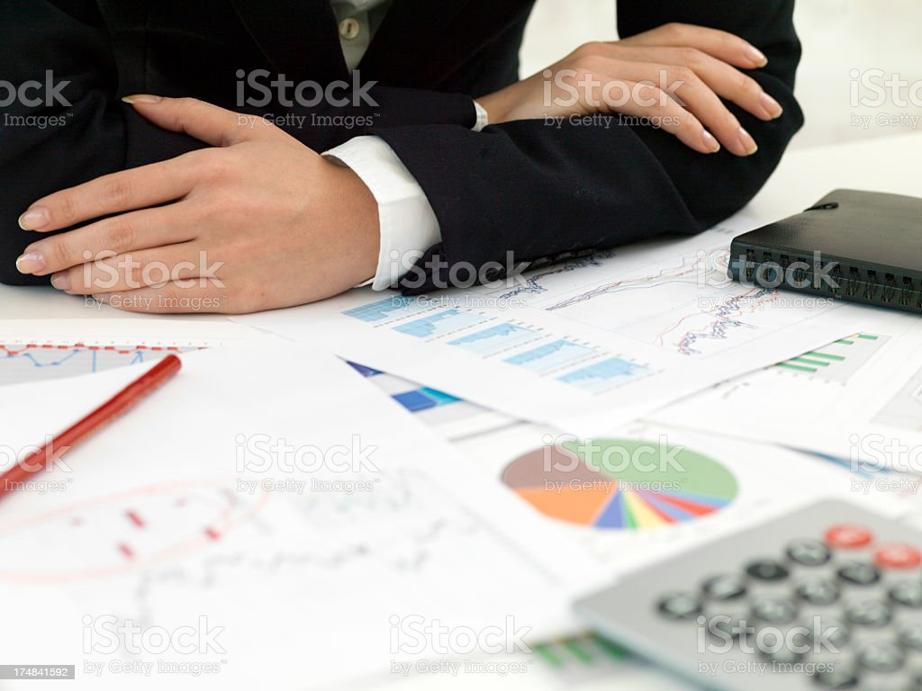 Business woman holding hers arm on the desk. royalty-free stock photo