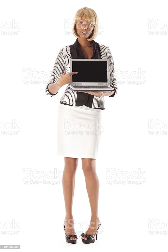 Business woman holding laptop pointing at screen royalty-free stock photo