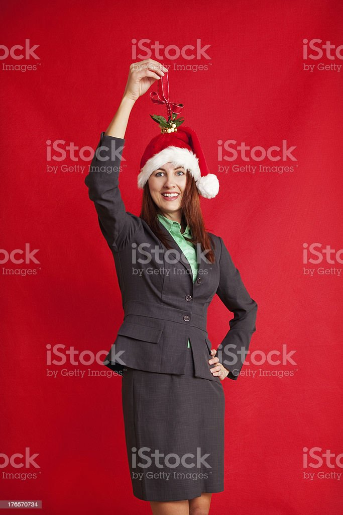 Business Woman Holding Mistletoe Over Her Head royalty-free stock photo