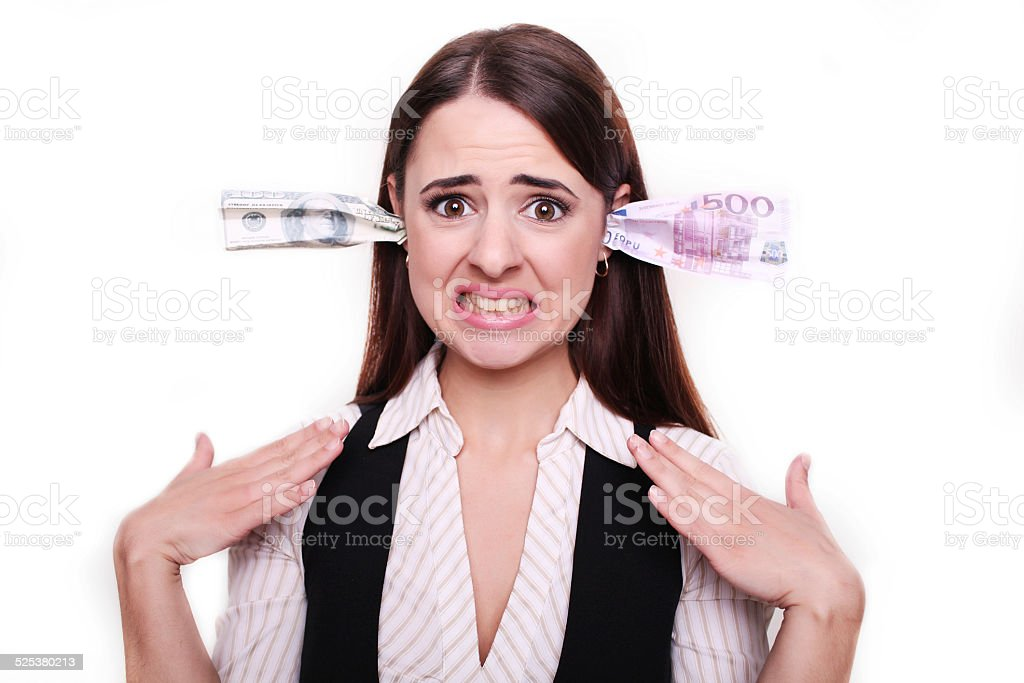 business woman holding money in the ears stock photo