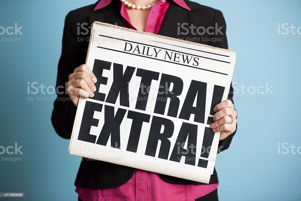 Business Woman Holding Newspaper with Extra! Headline stock photo