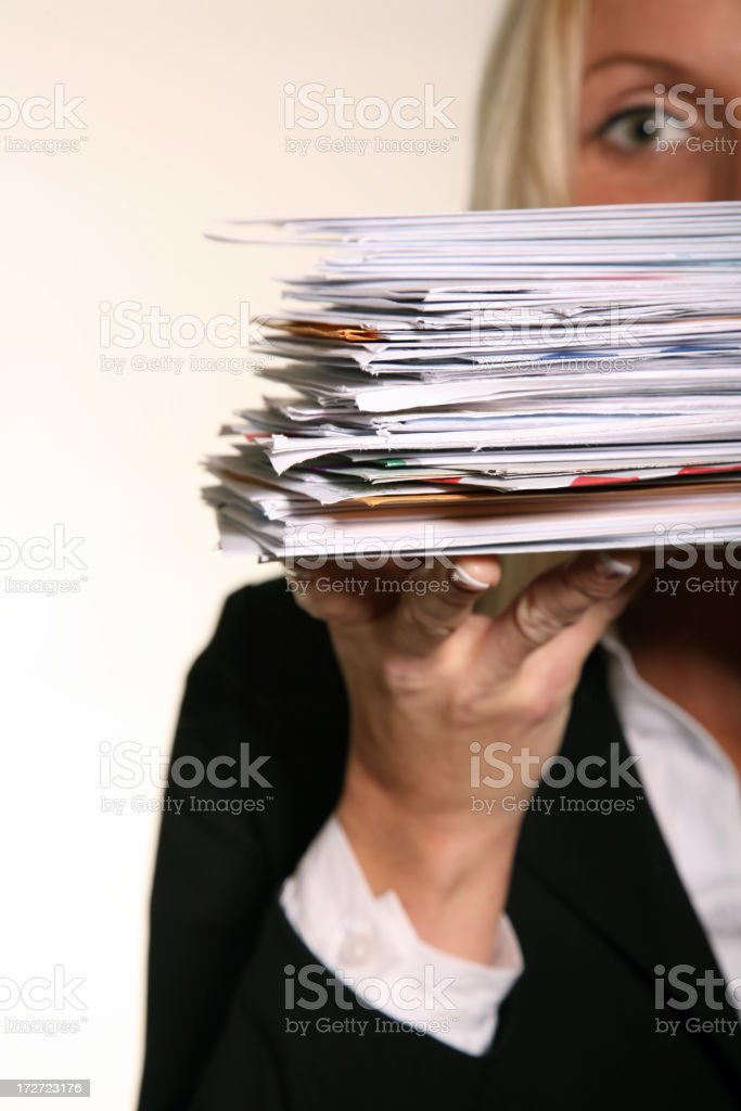 Business woman holding stack of Junk Mail and unpaid bills stock photo