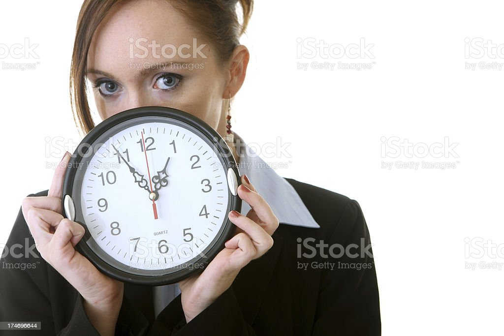 Business woman holding up clock royalty-free stock photo