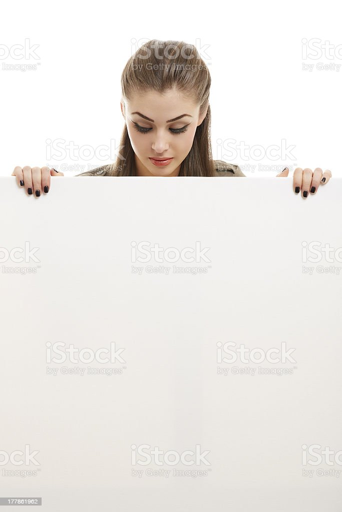 Business woman holding white billboard royalty-free stock photo