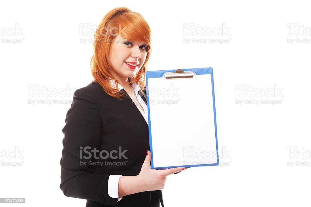 business woman holds clipboard and points royalty-free stock photo