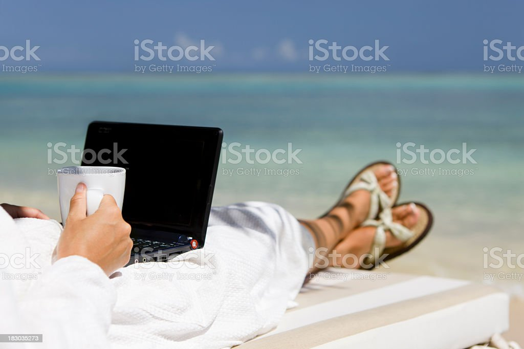 business woman in a robe and coffee working on laptop royalty-free stock photo
