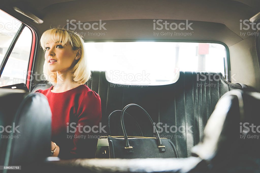 Business Woman In A Taxi Talking To The Driver stock photo