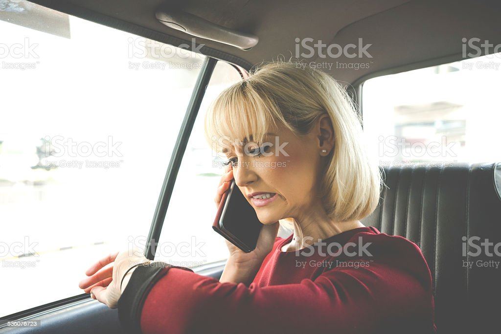 Business Woman In A Taxi, Weird Face stock photo