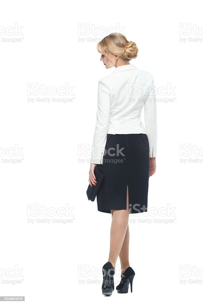 Business woman in an elegant suit to turn his back stock photo