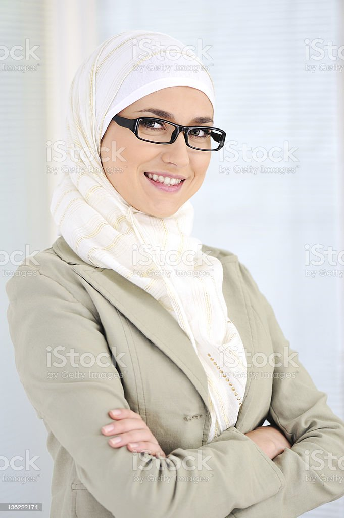 Business woman in an office feeling accomplished royalty-free stock photo