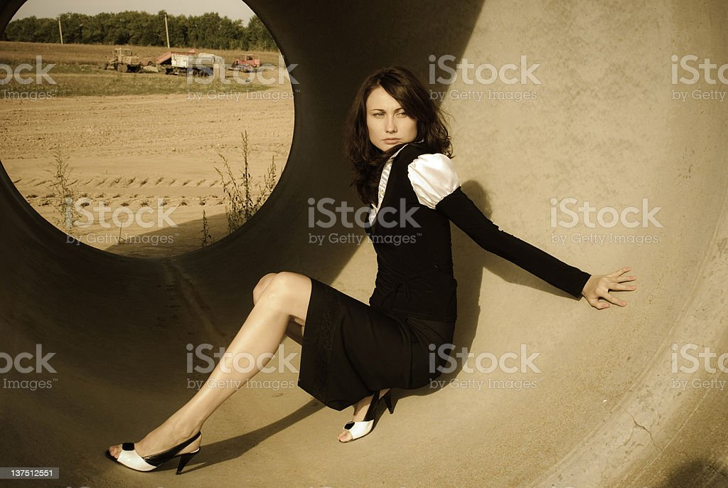 business woman in concrete pipe royalty-free stock photo