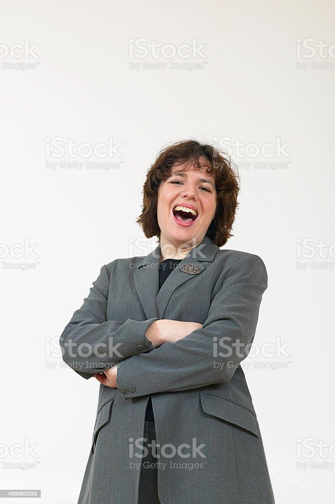 Femme d'affaires en costume gris rire photo libre de droits
