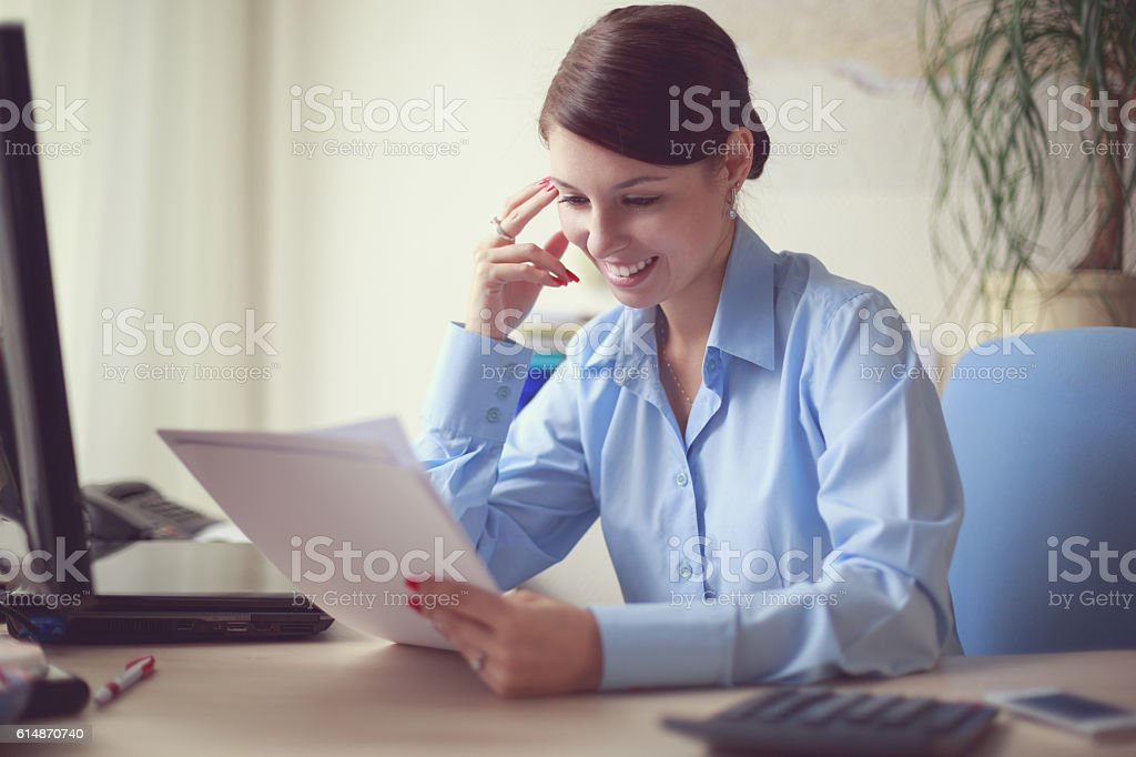 Business woman in her office stock photo
