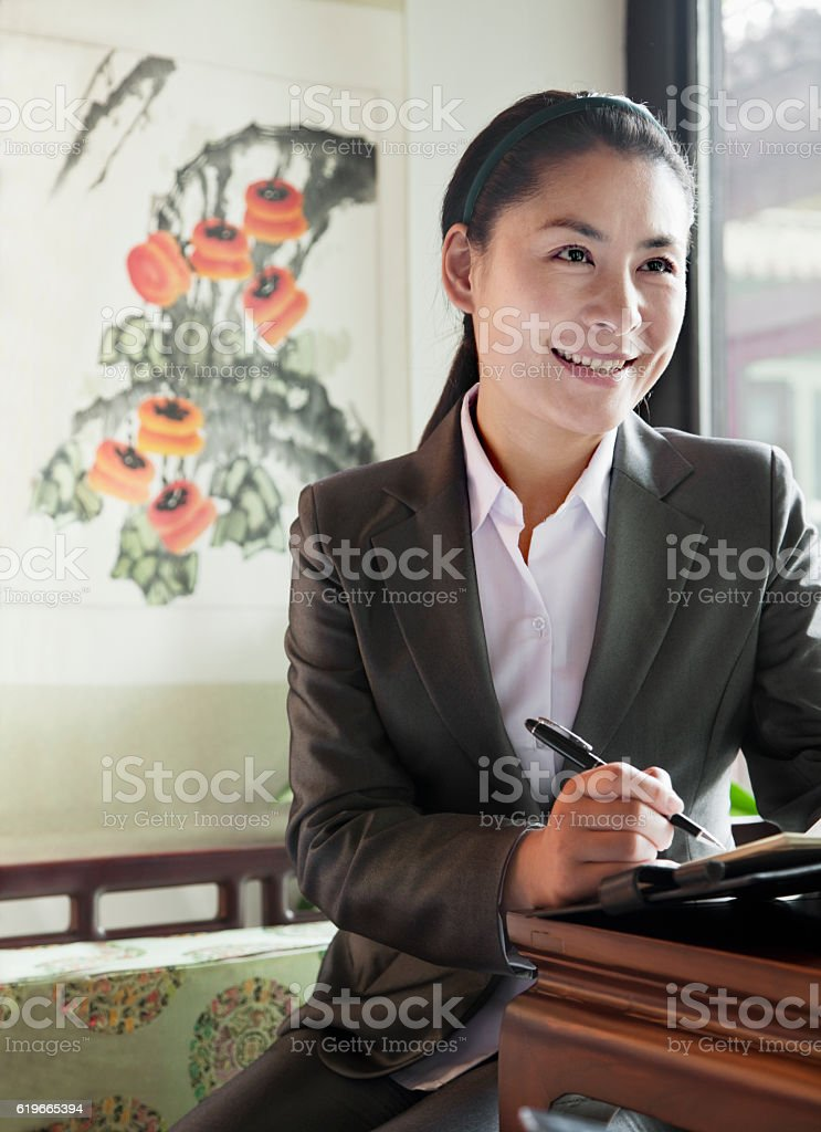 Business woman in meeting in traditional Chinese location stock photo