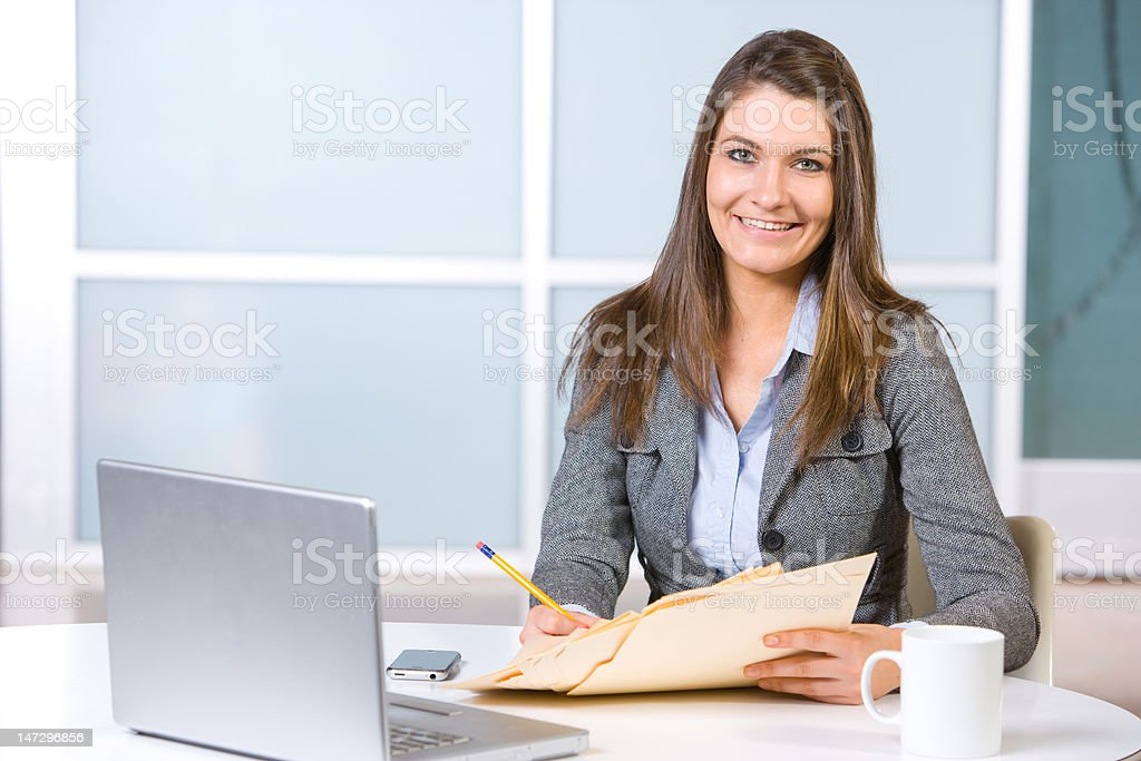 Business woman in modern office with laptop and coffee stock photo