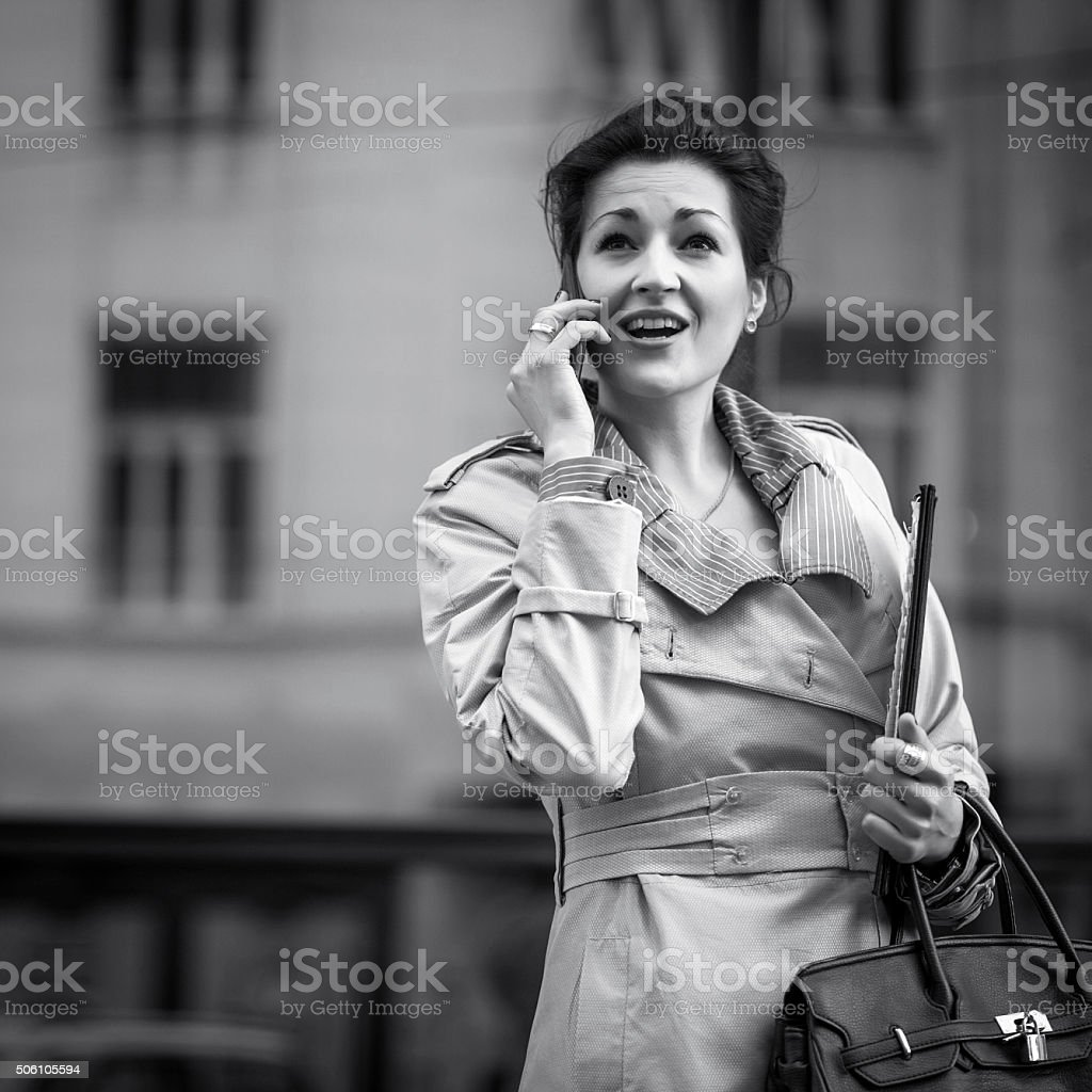 Business woman in the city talking on the phone stock photo