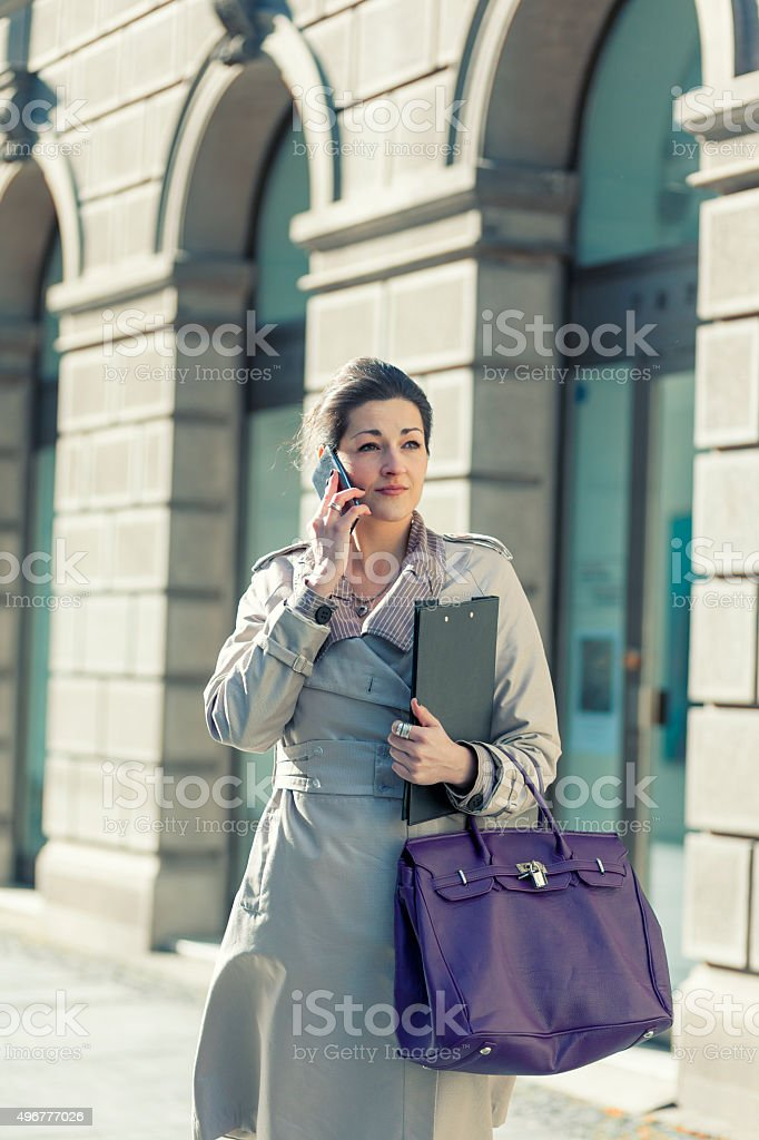 Business woman in the city talking with the phone stock photo